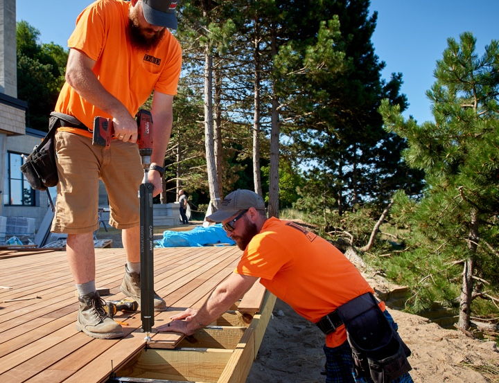 Contractors installing decking with DRIVE tool